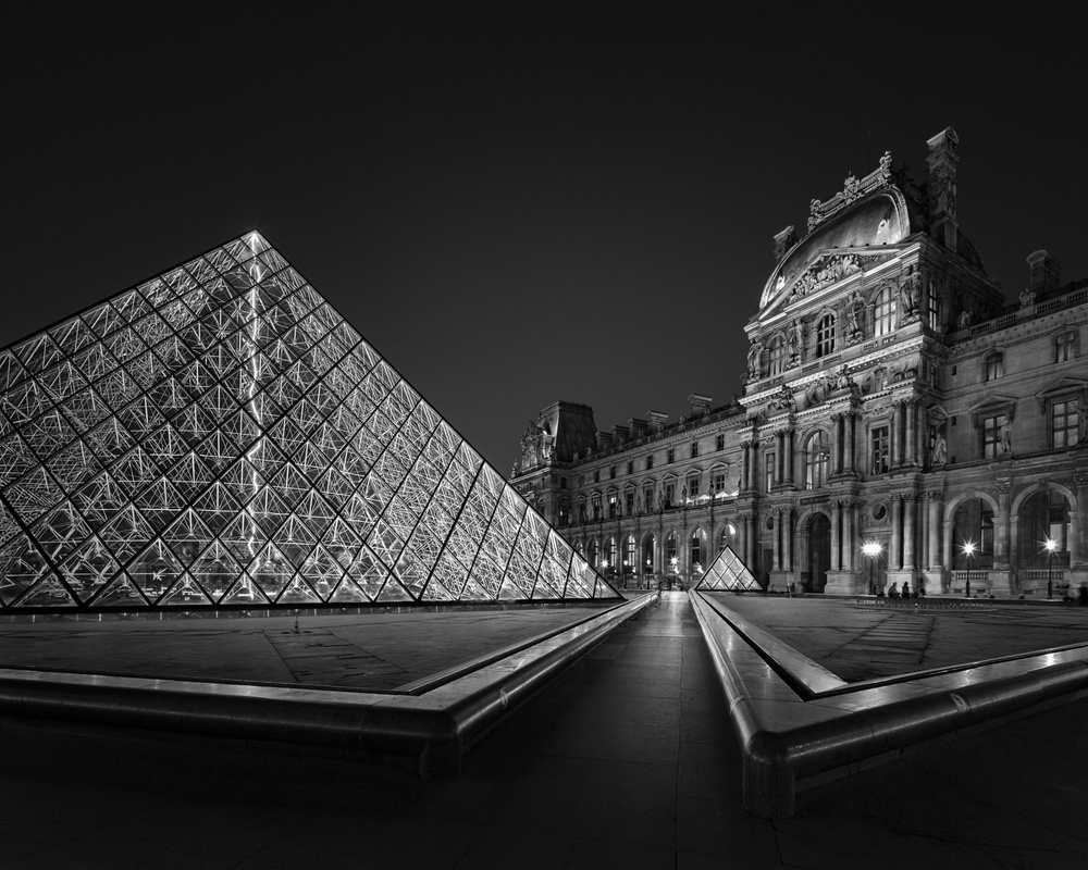 A piece of fine art art photography titled Midnight Light I - Paris Louvre Museum by Julia Anna Gospodarou