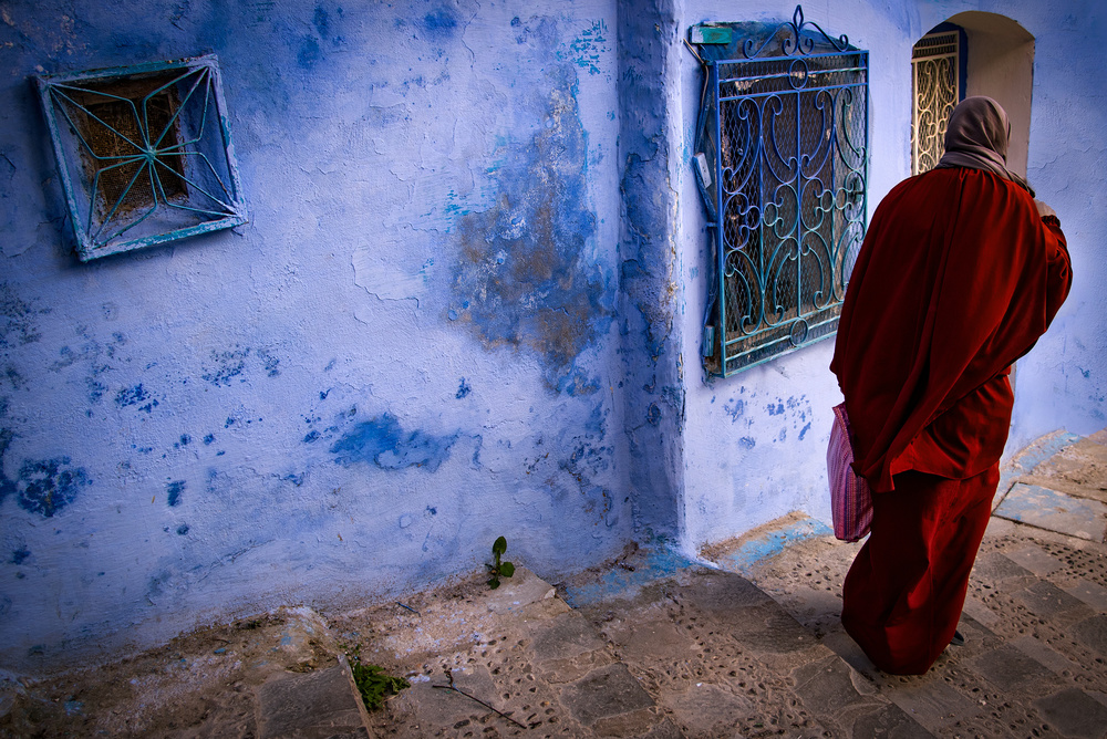 A piece of fine art art photography titled Lady In Red, Passing the Blue by Linda Wride