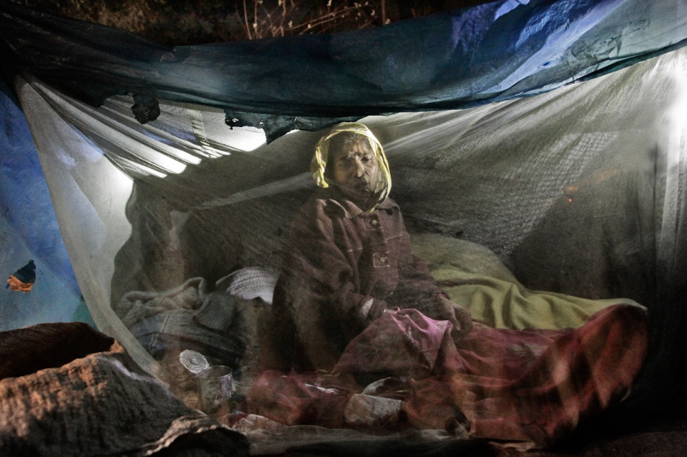 """Woman in her little house on the road, Dhaka. From """"Homeland"""" Bangladesh 2013"""