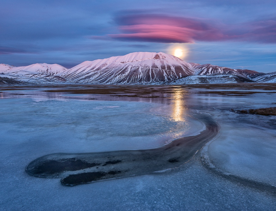 A piece of fine art art photography titled Pink Moonrise by Alessio Andreani