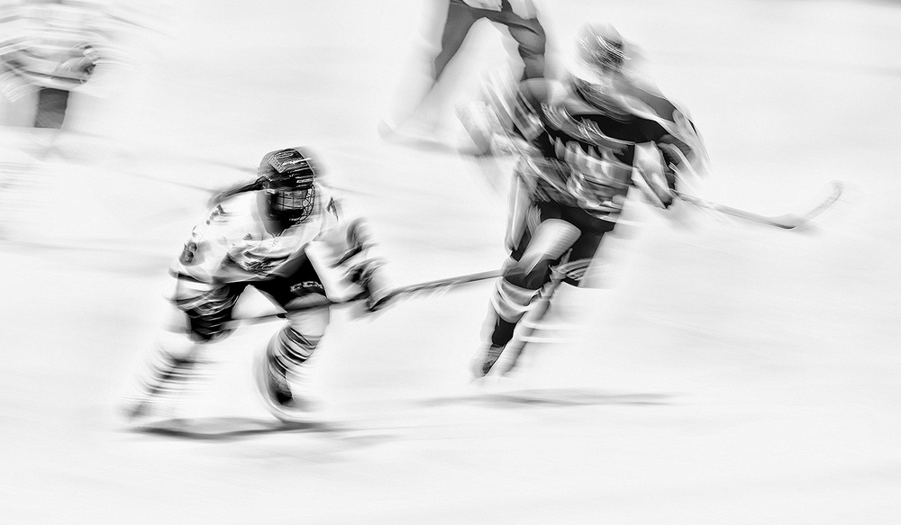 A piece of fine art art photography titled Hockey Player by Henry Zhao