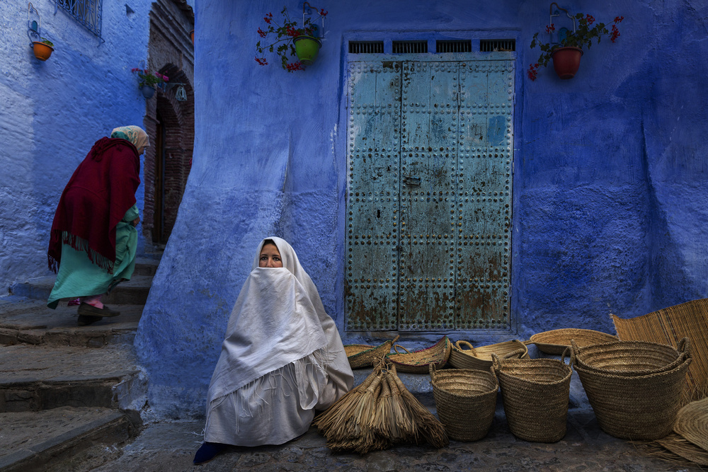 A piece of fine art art photography titled Chefchaouen Women by Fadhel Almutaghawi