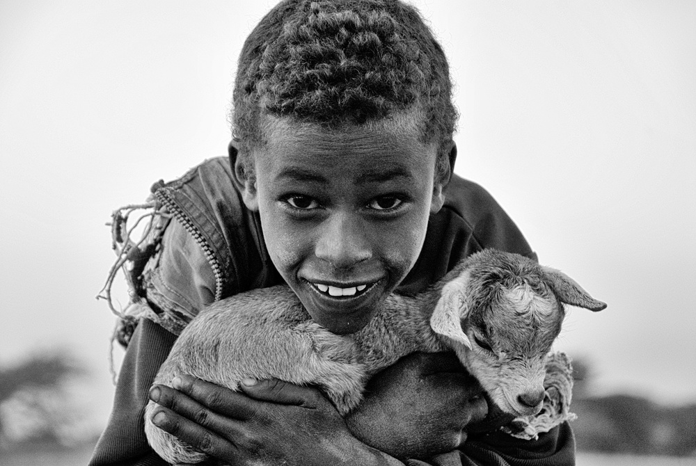 A piece of fine art art photography titled Boy With a Little Goat by Daniël Lousbergh