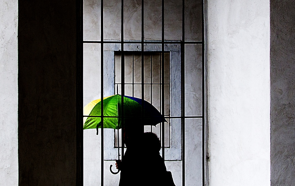 A piece of fine art art photography titled  Yellow, Green and Blue Umbrella by franco maffei