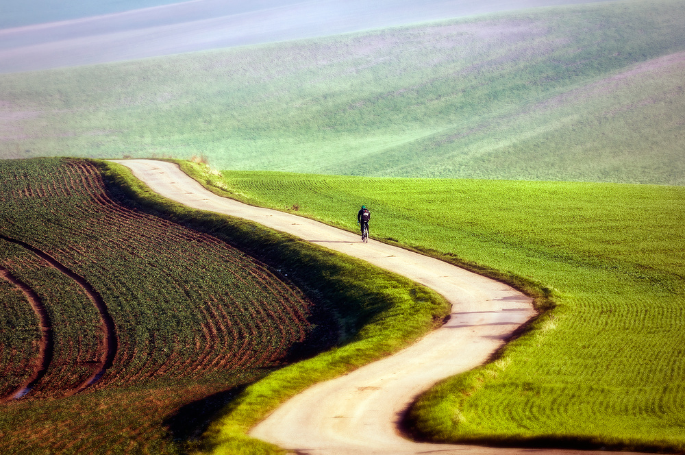 A piece of fine art art photography titled Bicyclist by Piotr Krol (Bax)
