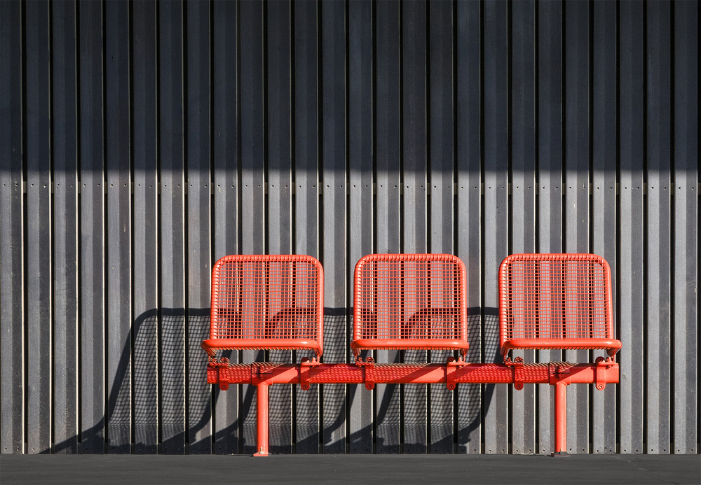A piece of fine art art photography titled The Red Trio by Jef Van den Houte