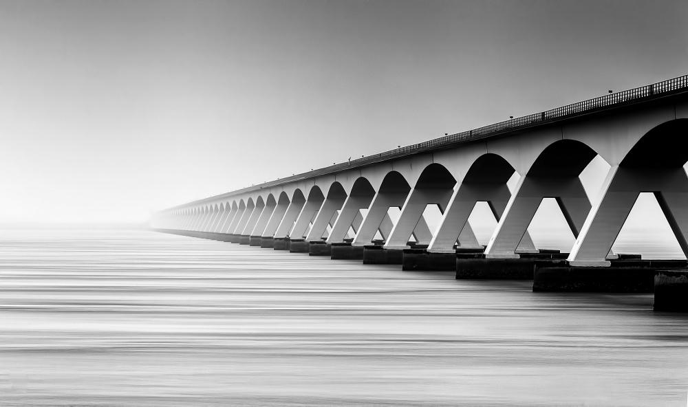 A piece of fine art art photography titled The Endless Bridge by wim denijs