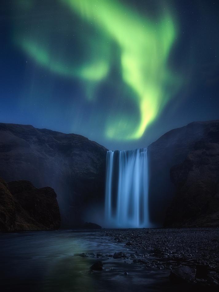 A piece of fine art art photography titled Skogafoss Aurora by Daniel Fleischhacker