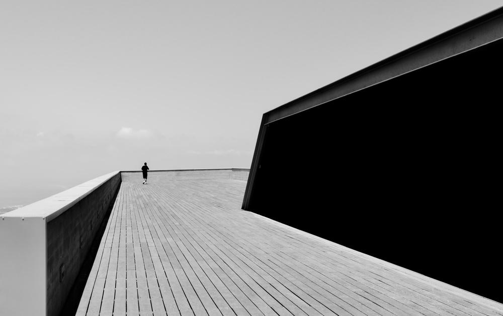 Man on wooden terrace BW