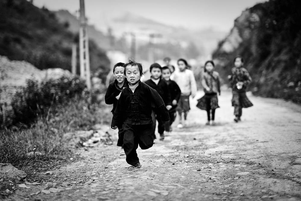 A piece of fine art art photography titled Children In the Northernmost Village of Vietnam by Milan Schirlo