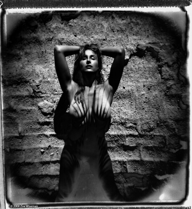 A piece of fine art art photography titled Vassanta In Palm Shadow by Zoe Wiseman