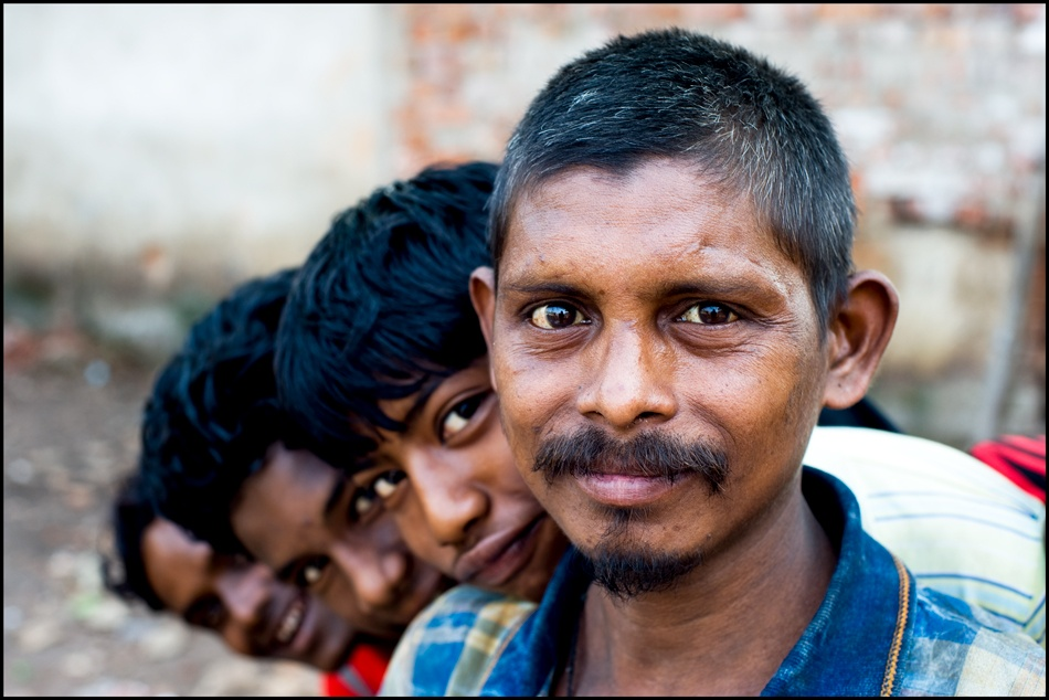 A piece of fine art art photography titled Rajesh and His Sons by Robert