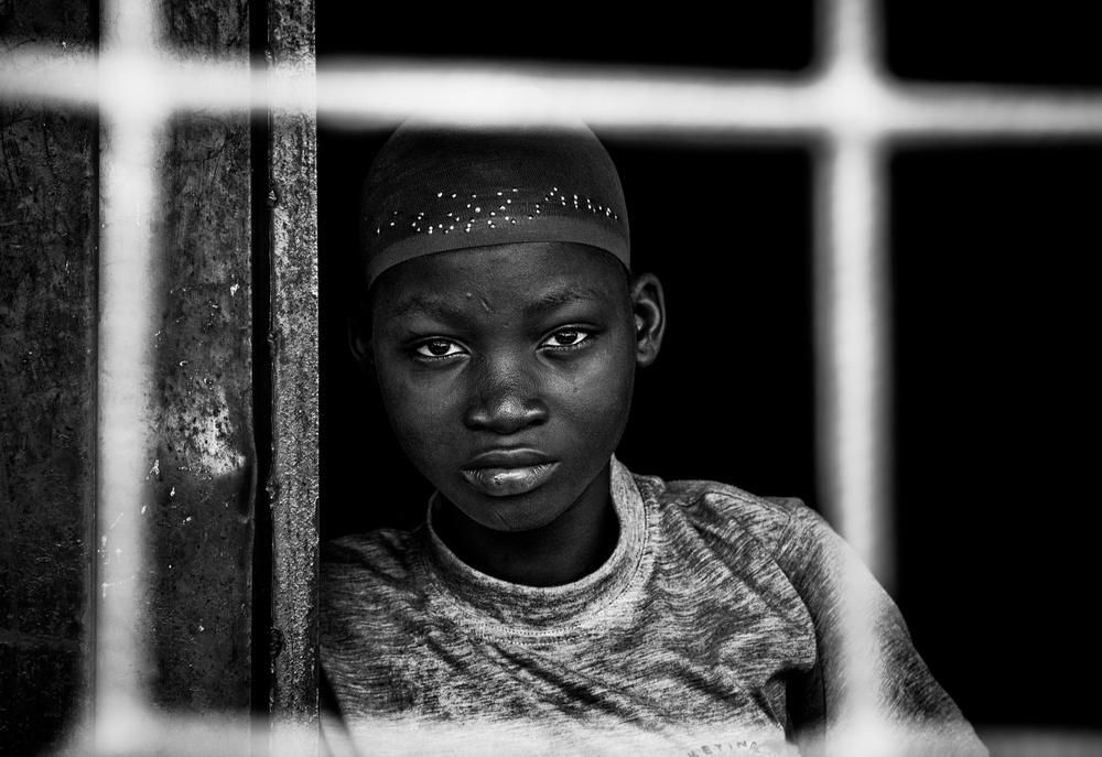 A piece of fine art art photography titled Boy from Benin-II by Joxe Inazio Kuesta Garmendia
