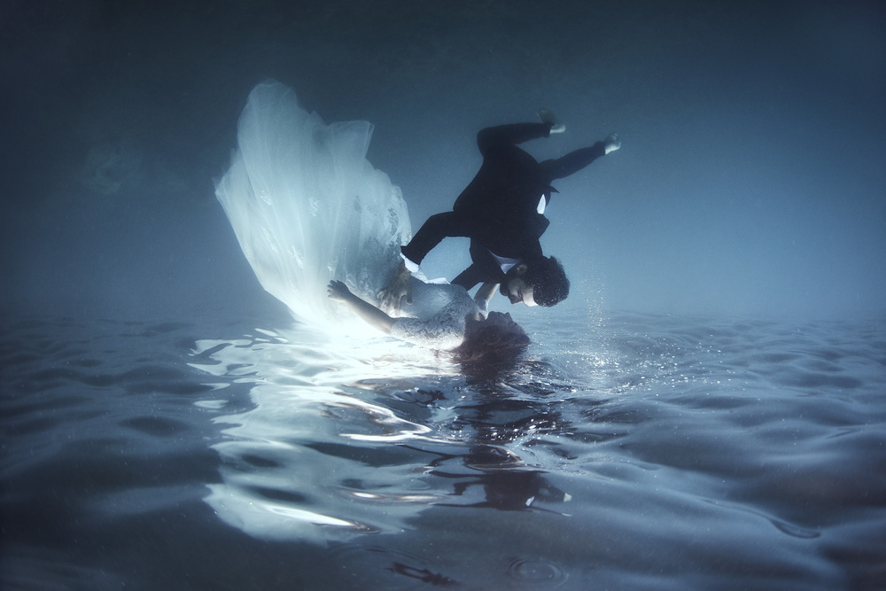 A piece of fine art art photography titled Underwater Trash the Dress by Davide Lopresti