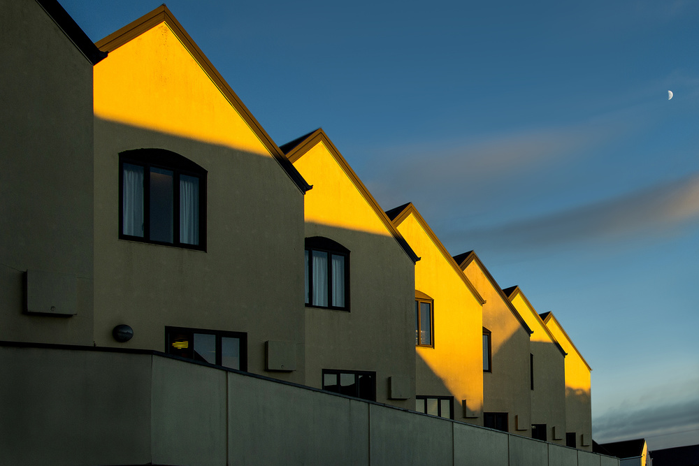 A piece of fine art art photography titled The Yellow House and Half Moon by Ekkachai Khemkum