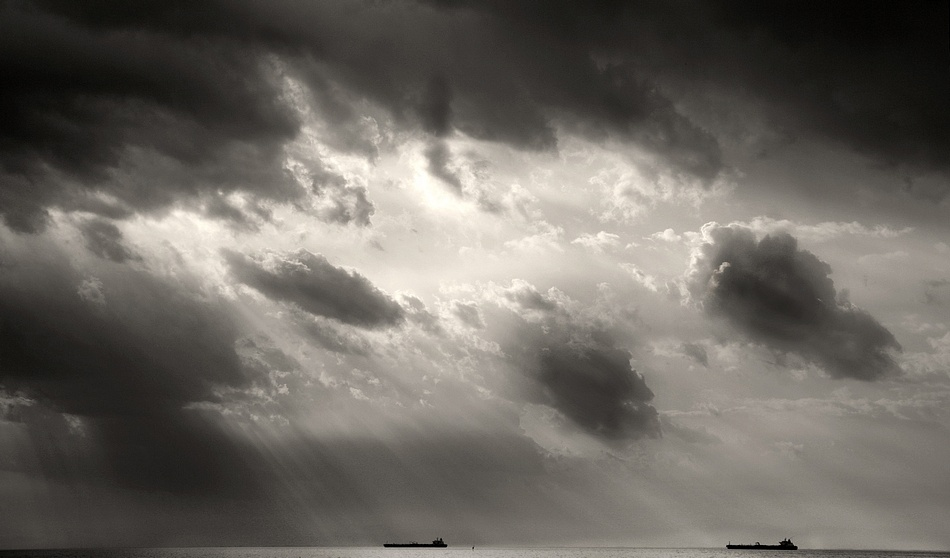 A piece of fine art art photography titled Ships Under a Black Sky by Giorgio Lorcet