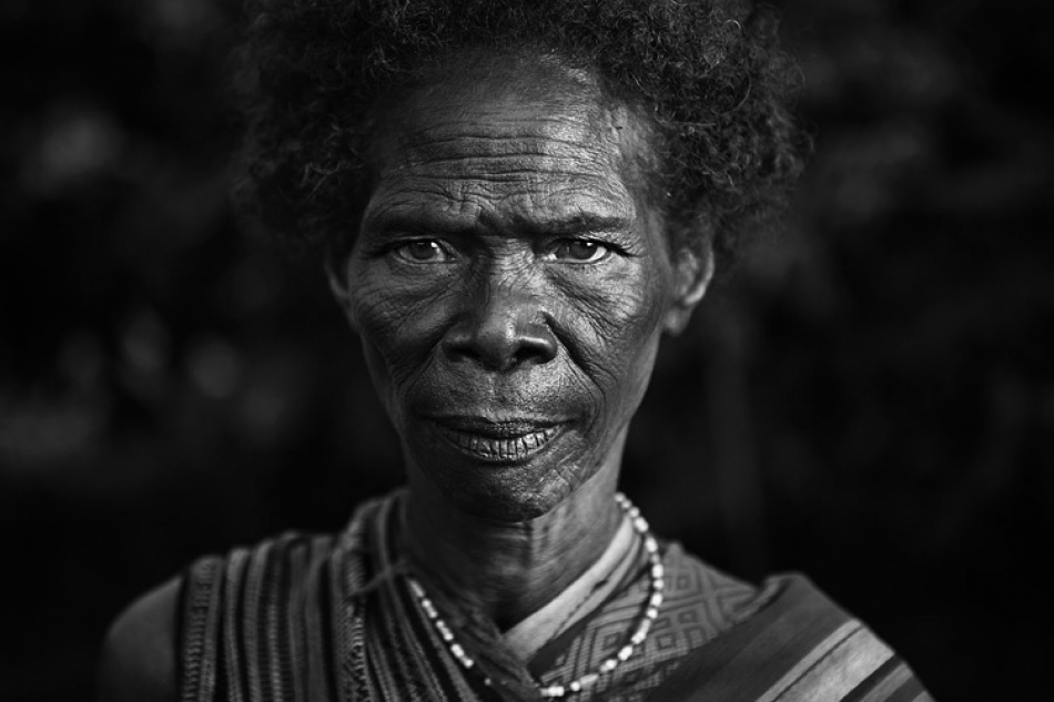 A piece of fine art art photography titled Abui Tribal Woman by Mitchell Kanashkevich