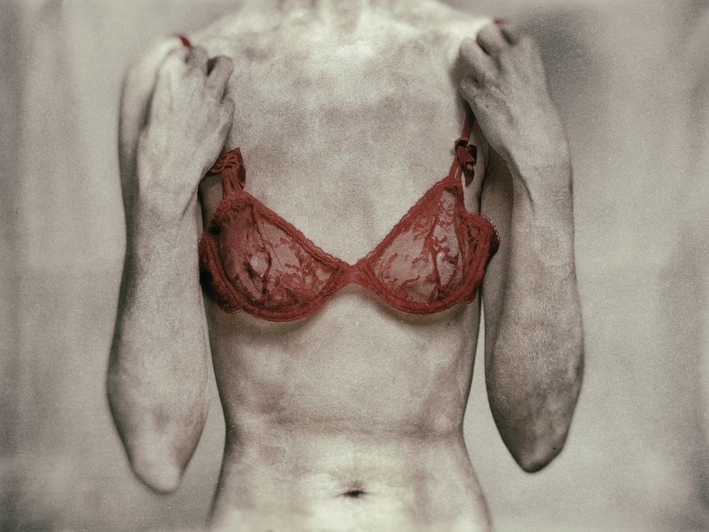 A piece of fine art art photography titled Taking the Bra Off by Ton Dirven