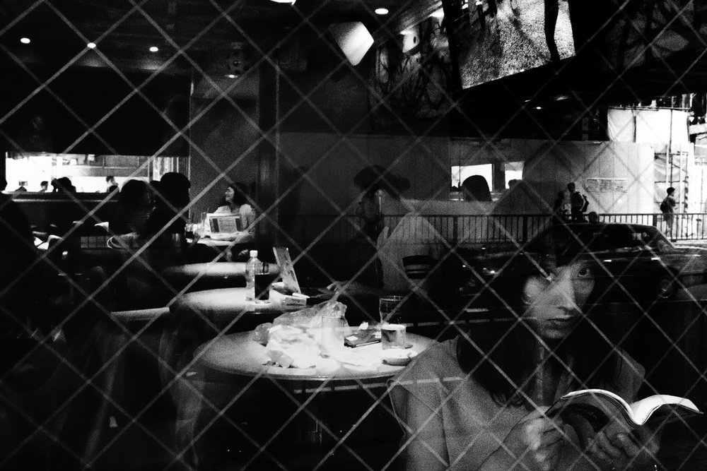 A piece of fine art art photography titled Cafe by Tatsuo Suzuki
