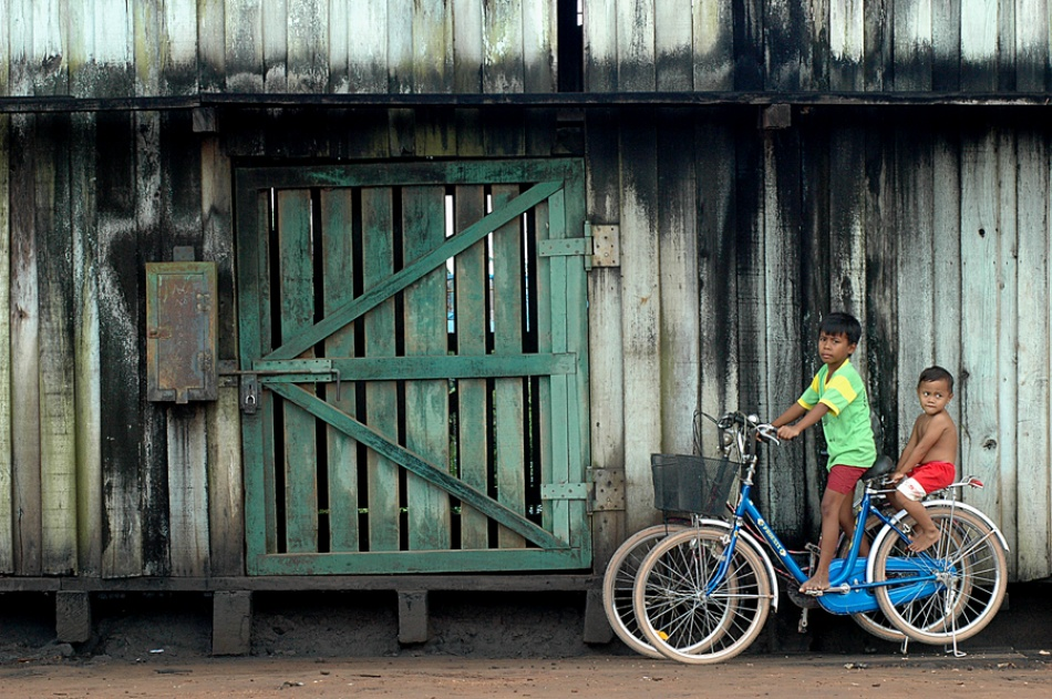 A piece of fine art art photography titled On the Bike by Wawan Setiawan