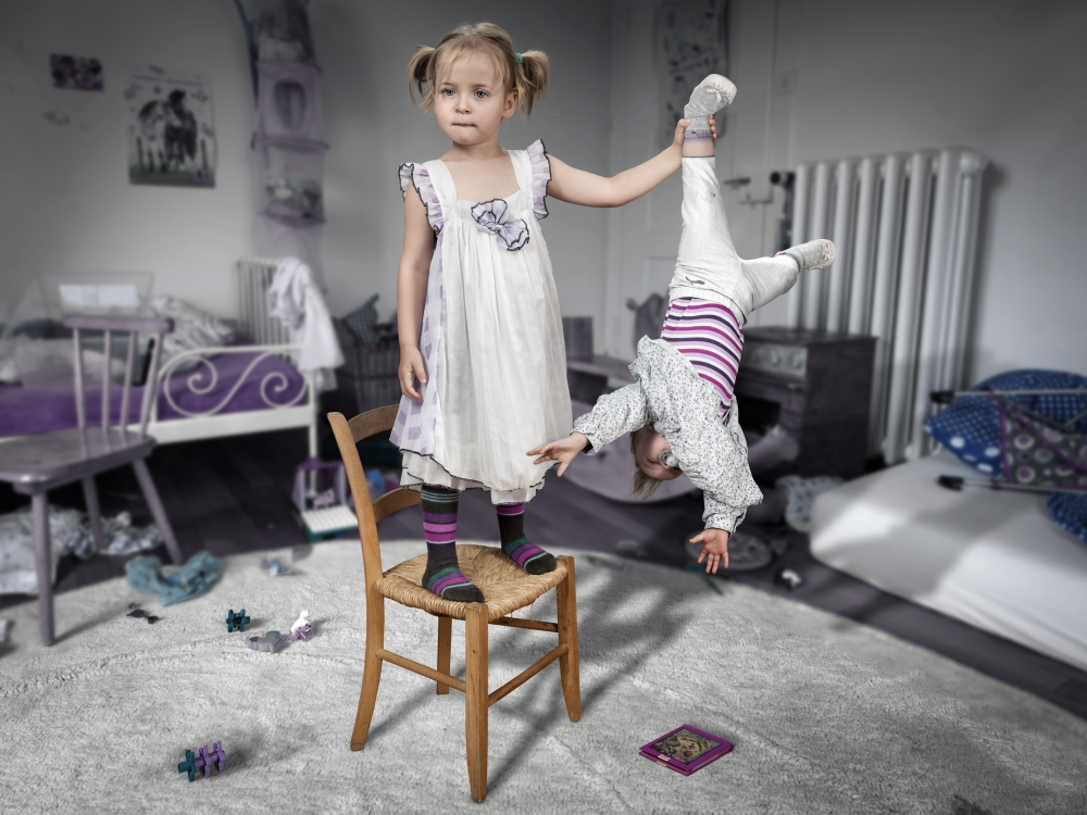 A piece of fine art art photography titled Don\'t Touch My Book Little Sister! by John Wilhelm