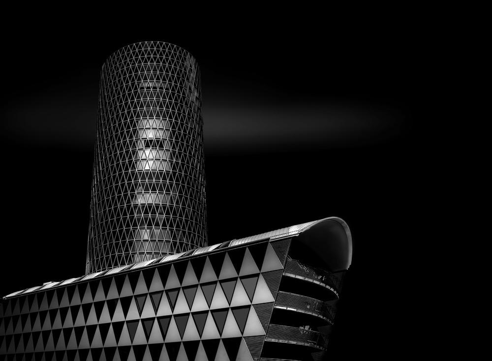 A piece of fine art art photography titled Westhafen Tower Frankfurt by Adam Fritzen