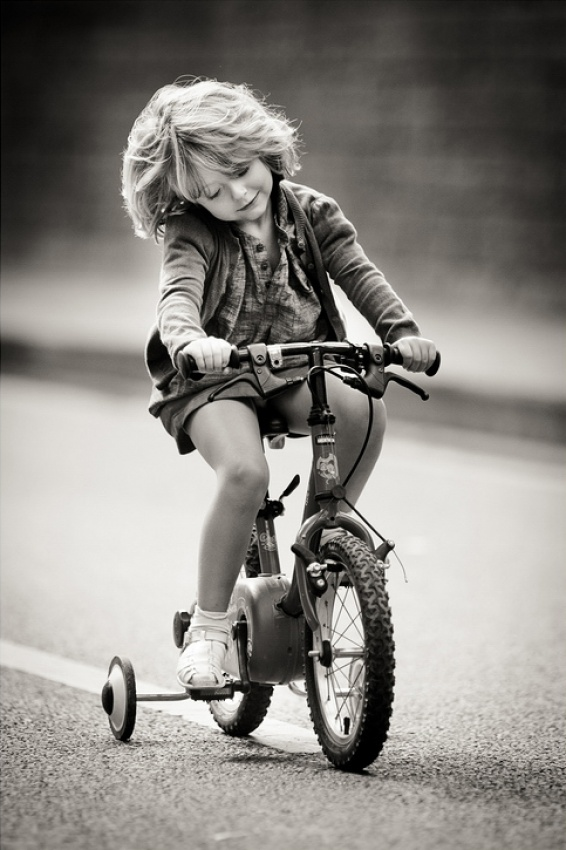 A piece of fine art art photography titled The Little Girl On the Bike by Laurent DUFOUR