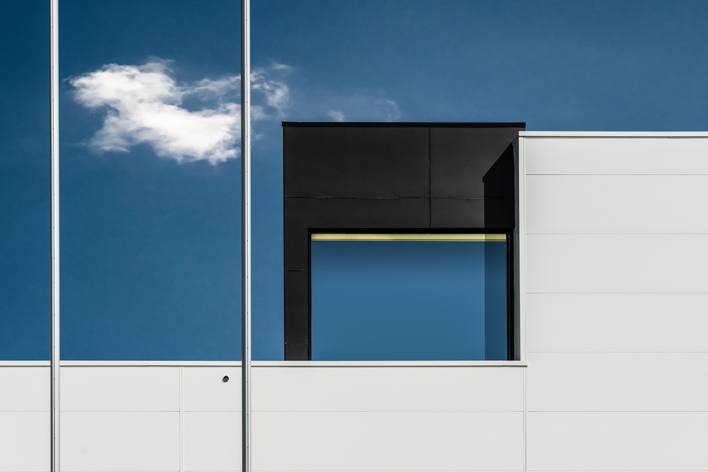 A piece of fine art art photography titled Two Flagpoles, a Cloud and a Window by Luc Vangindertael (laGrange)