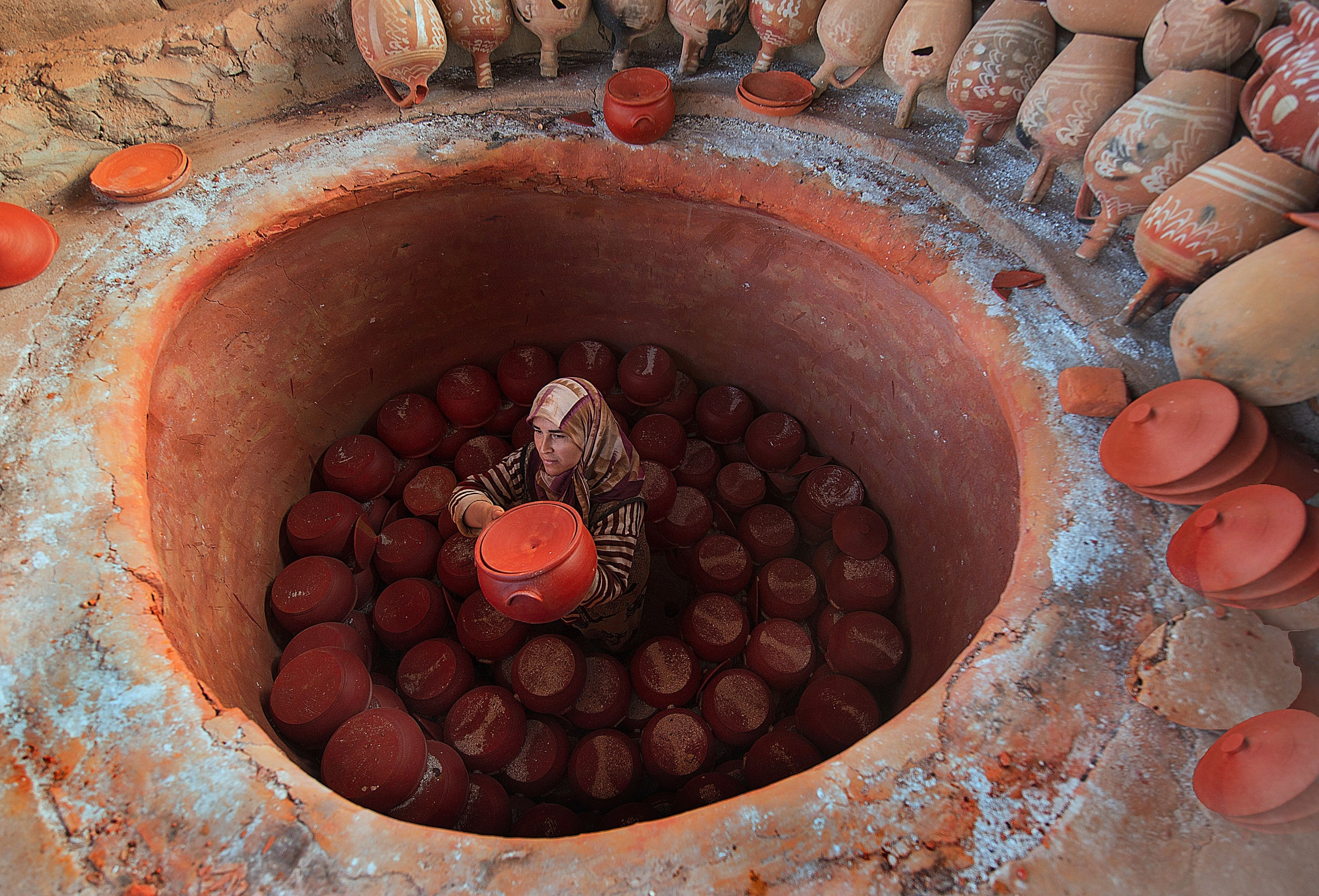 A piece of fine art art photography titled Pottery Making by fethi turgut