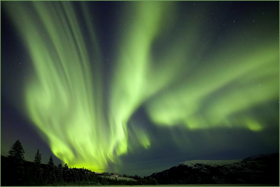 A piece of fine art art photography titled Aurora Over Hauan by Eskil Olsen