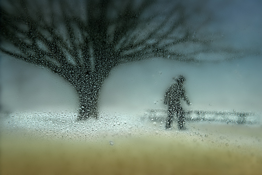 A piece of fine art art photography titled Man In Nature - Winter by Shenshen Dou