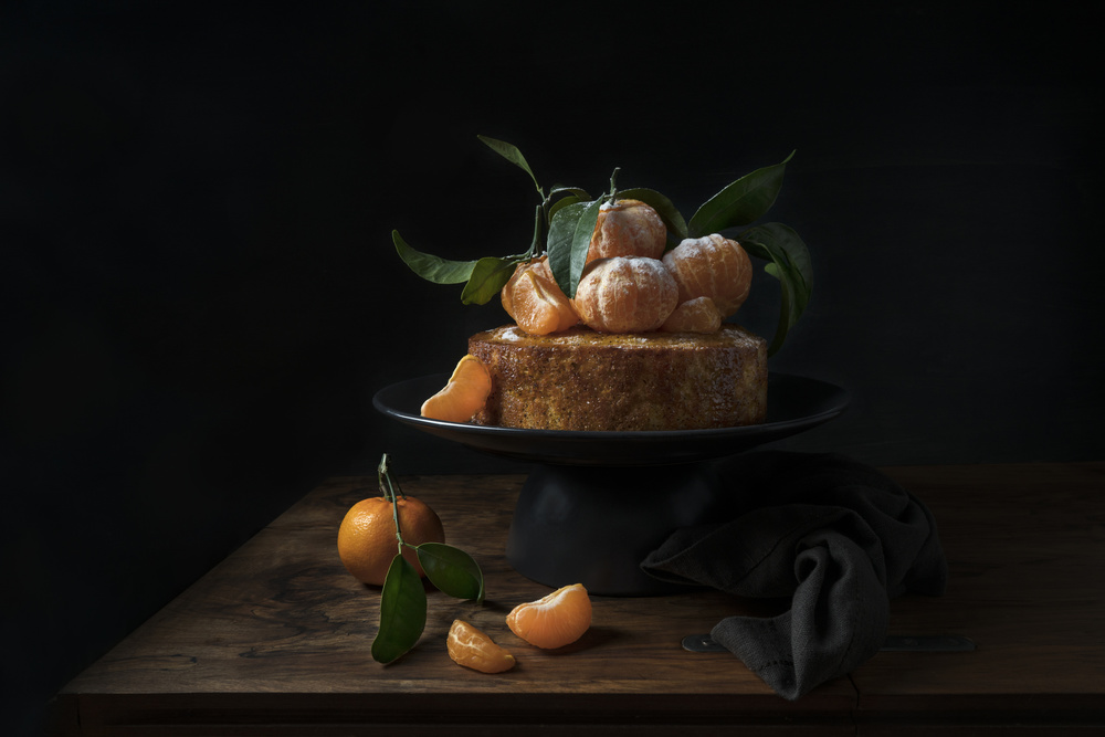 View this piece of fine art photography titled Polenta cake with sweet mandarines by Lotte Grønkjær