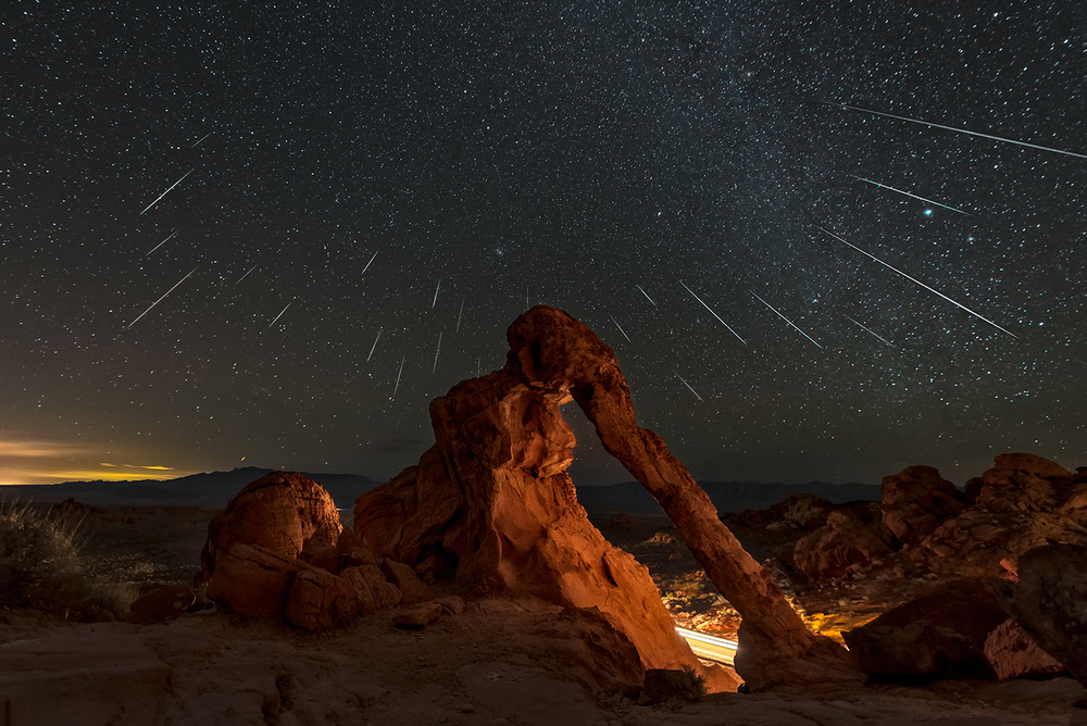 A piece of fine art art photography titled Geminid Meteor Shower Above the Elephant Rock by Hua Zhu