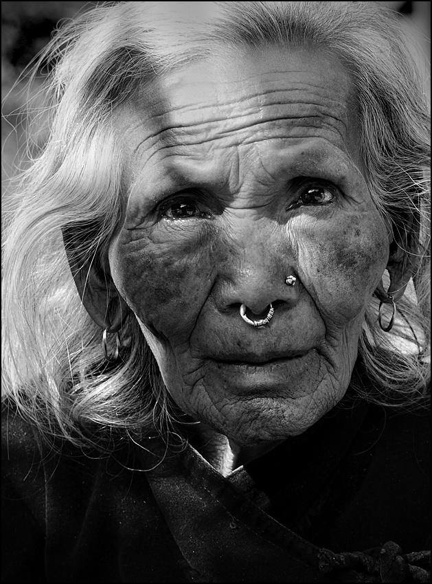 A piece of fine art art photography titled Nepali Face by sensorfleck