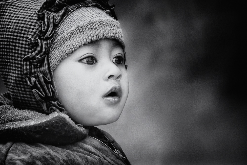 A piece of fine art art photography titled The Kid from Sarangkot by Piet Flour