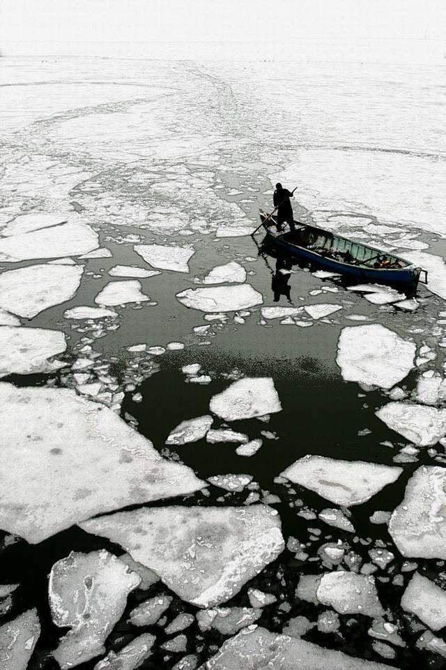 A piece of fine art art photography titled Boatman On Ice by Murat OZEL