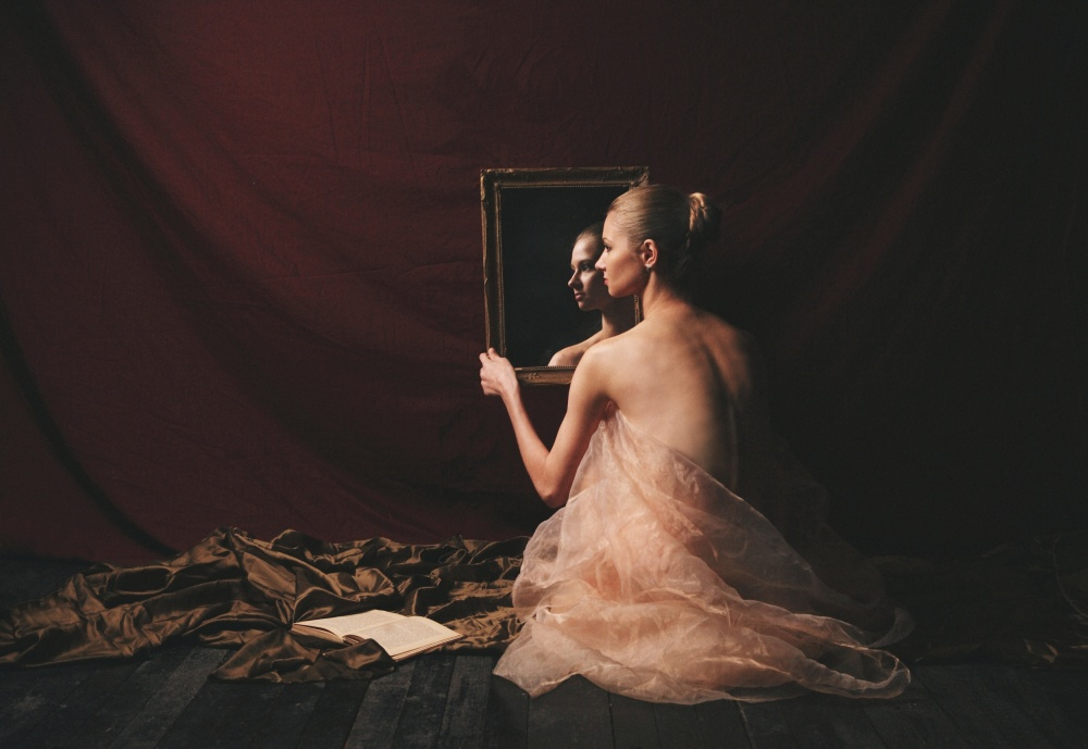 A piece of fine art art photography titled Woman With Mirror and Book by Kiril Stanoev