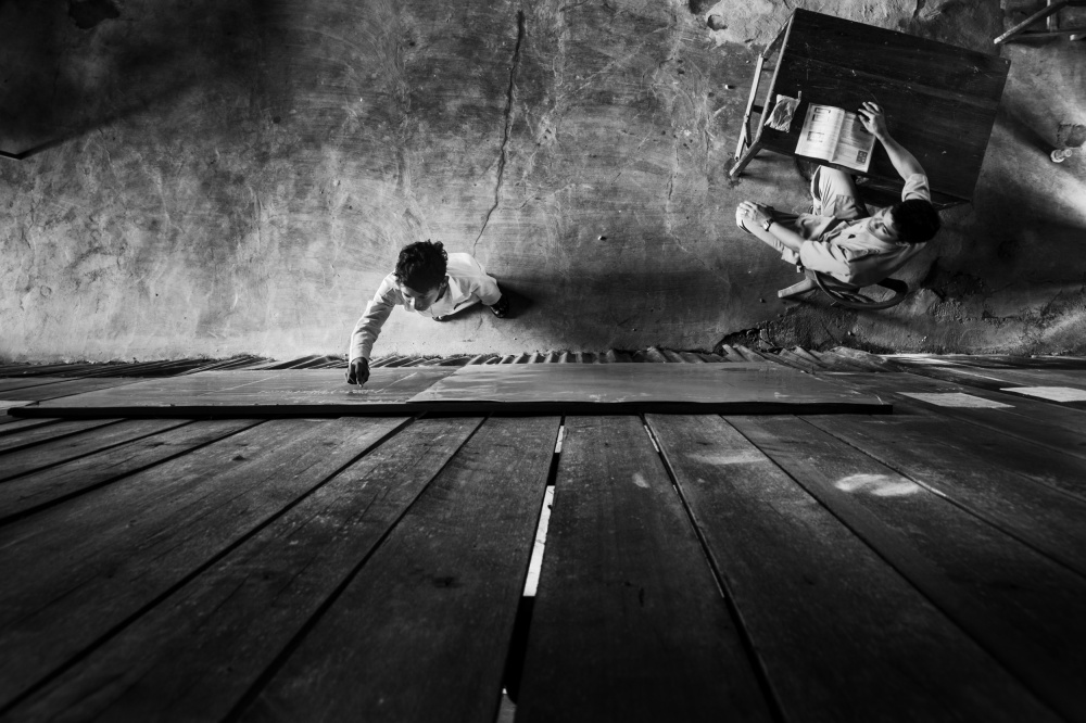 A piece of fine art art photography titled Studying by Zulkifli Thalib