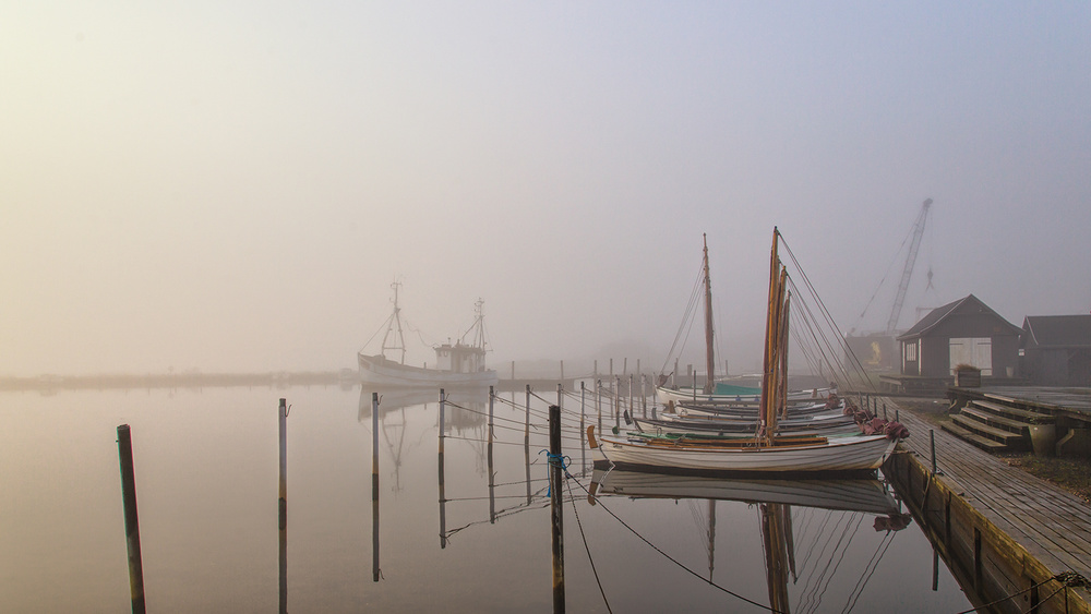 A piece of fine art art photography titled Morning Mood at the Harbor by Leif Løndal