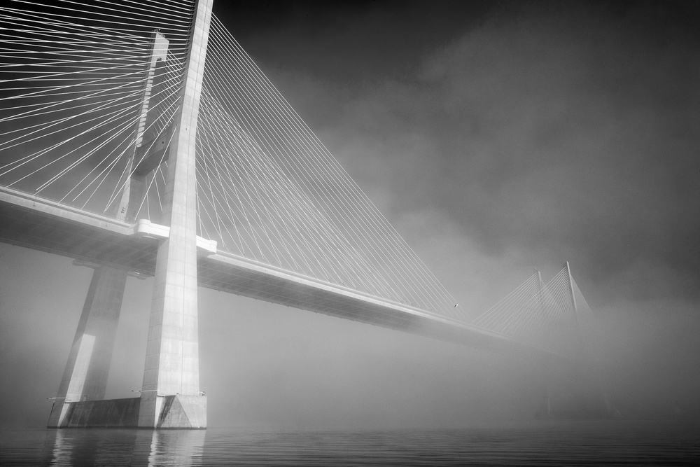 A piece of fine art art photography titled Foggy Bridge by Fabio Palmerini