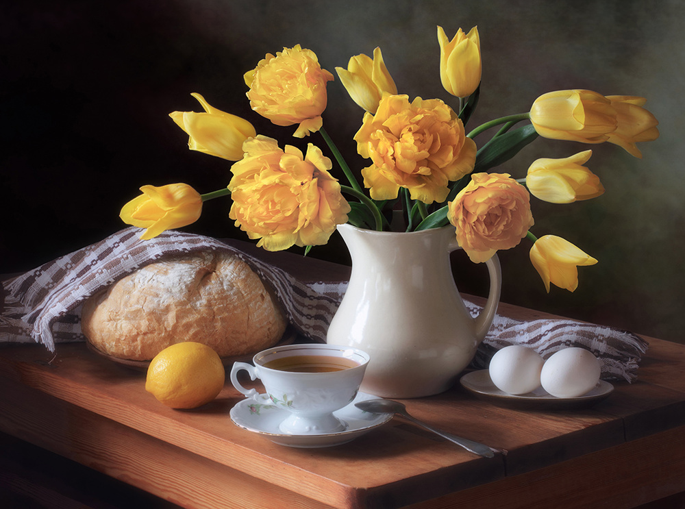 Still life with a bouquet of yellow tulips