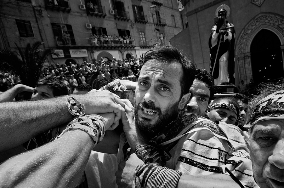 A piece of fine art art photography titled Bearers of St Calò by Enzo Penna