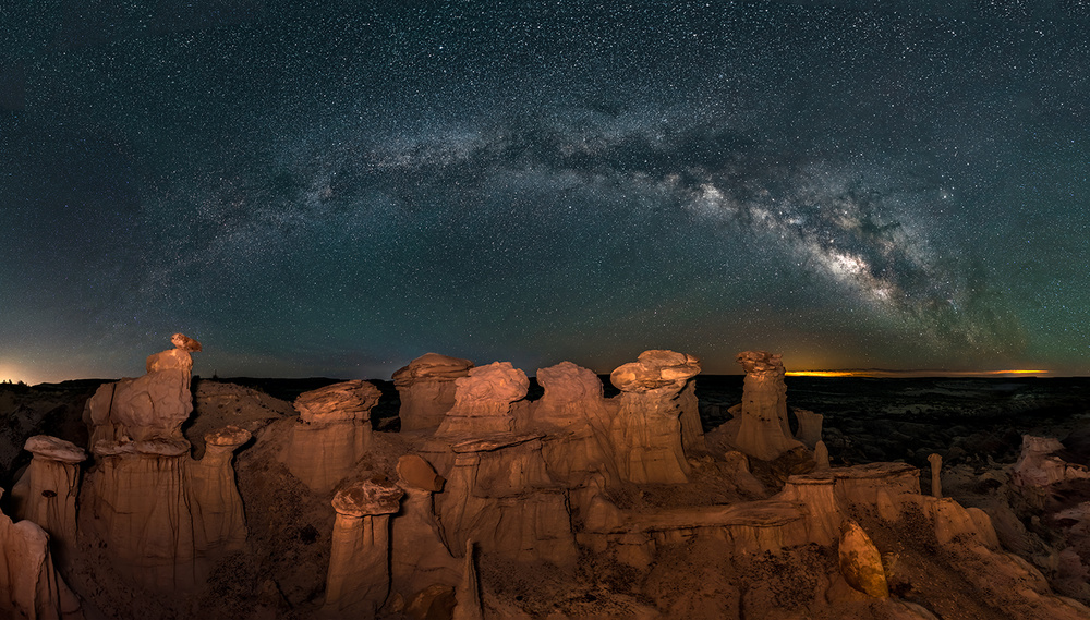 A piece of fine art art photography titled Milky Way Over Bisti/De-Na-Zin Wilderness by Hua Zhu