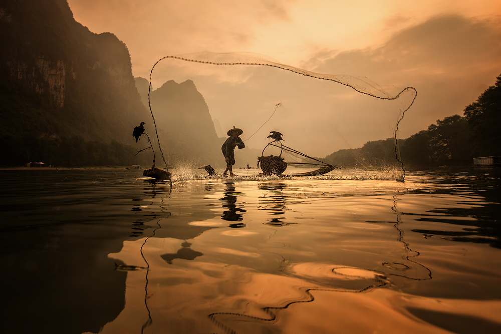 A piece of fine art art photography titled Spread the Fish Nets by Gunarto Song
