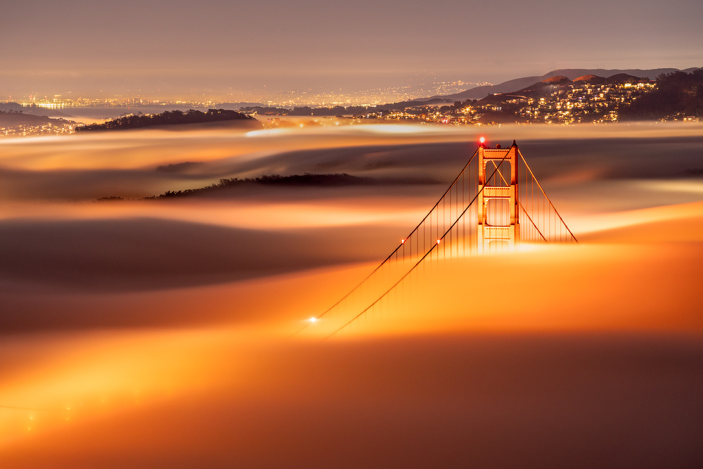 View this piece of fine art photography titled Golden Gate Bridge covered by low fog. by jennie jiang