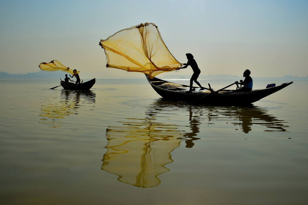 A piece of fine art art photography titled Throwing for Survival by anant5992
