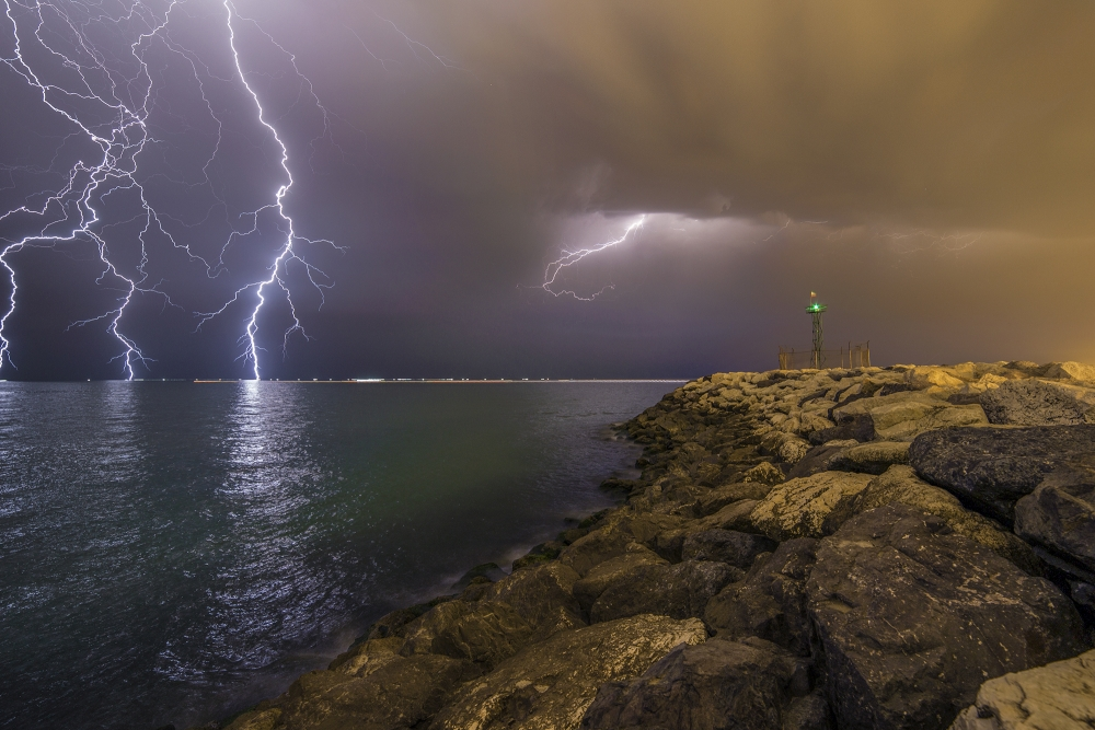 A piece of fine art art photography titled When Lightning Strikes by Mehdi Momenzadeh