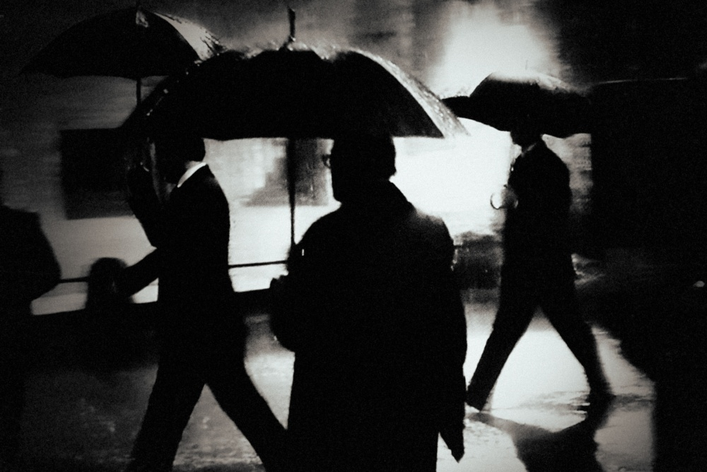 A piece of fine art art photography titled Men In the Rain by holger droste