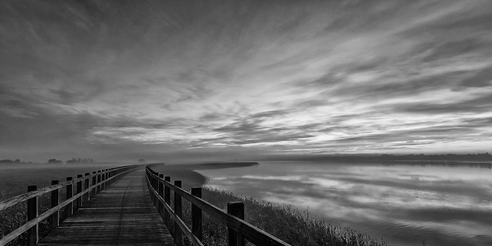 A piece of fine art art photography titled The Long Wooden Footbridge Dark Version by Leif Løndal