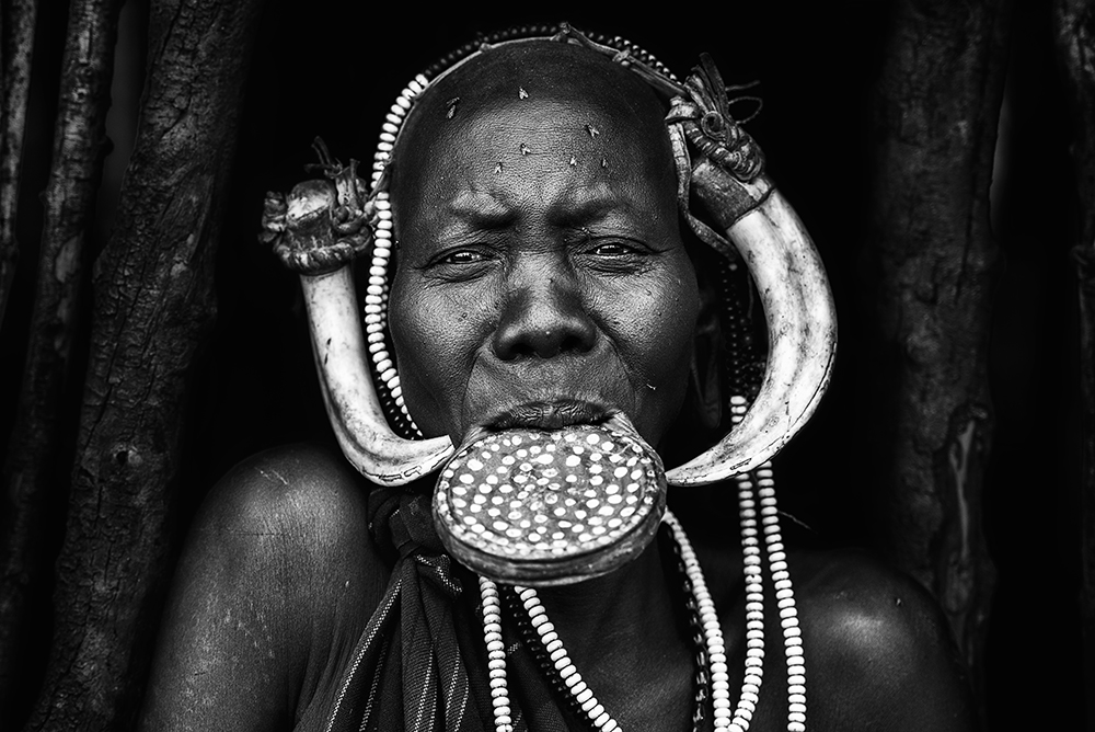 A piece of fine art art photography titled Portrait of Mursi Tribe by Herman Morrison
